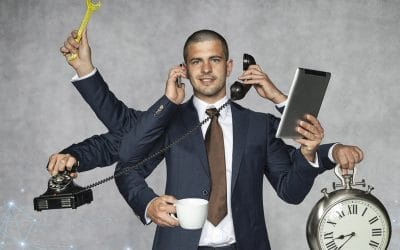 A male manager who is virtually holding numerous objects and tools that are used to evaluate employees
