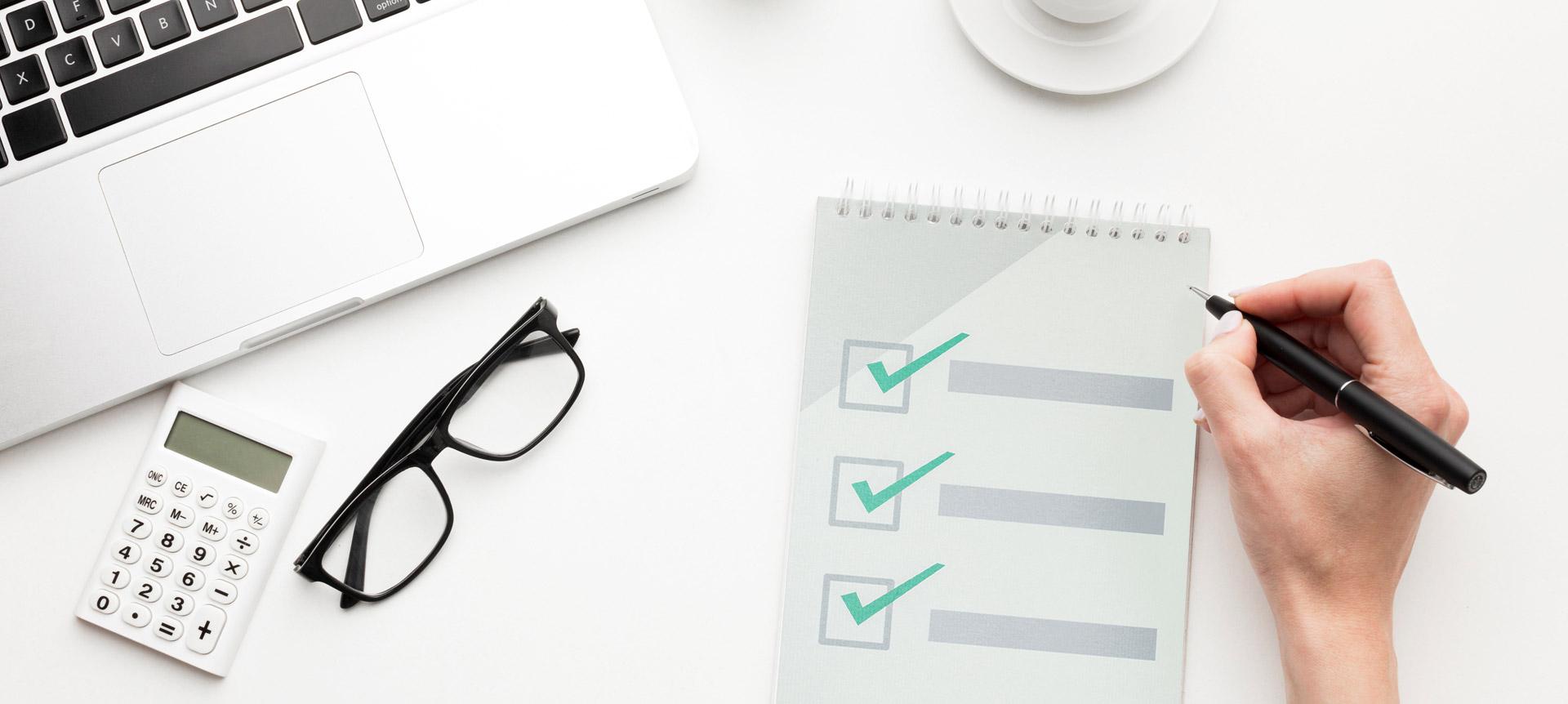 A recruiter writing a checklist