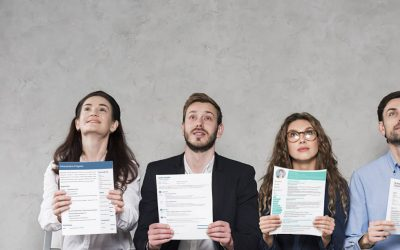 A picture of candidates holding up their CVs