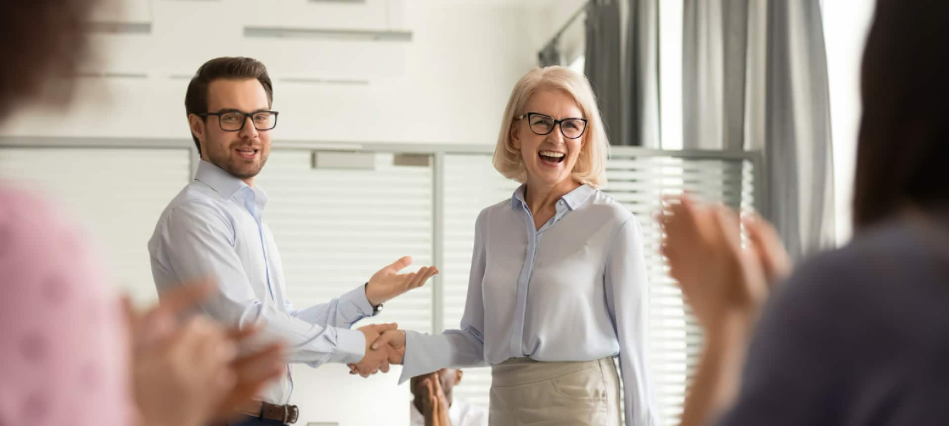A manager rewarding his employee for living up to the company's core values