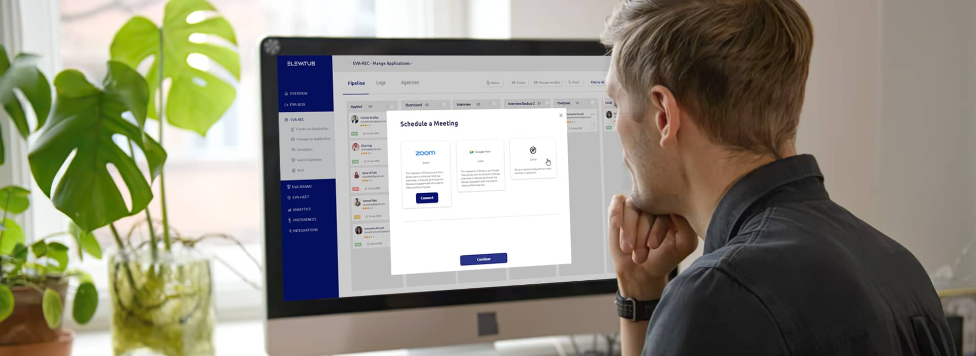 A male recruiter using an applicant tracking system