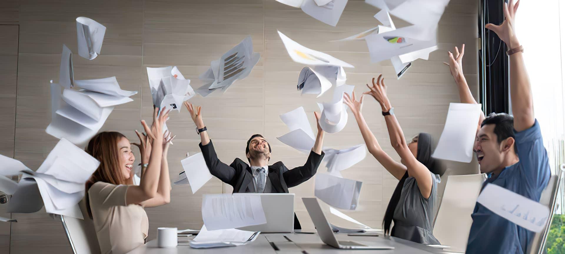A talent acquisition team celebrating hiring success