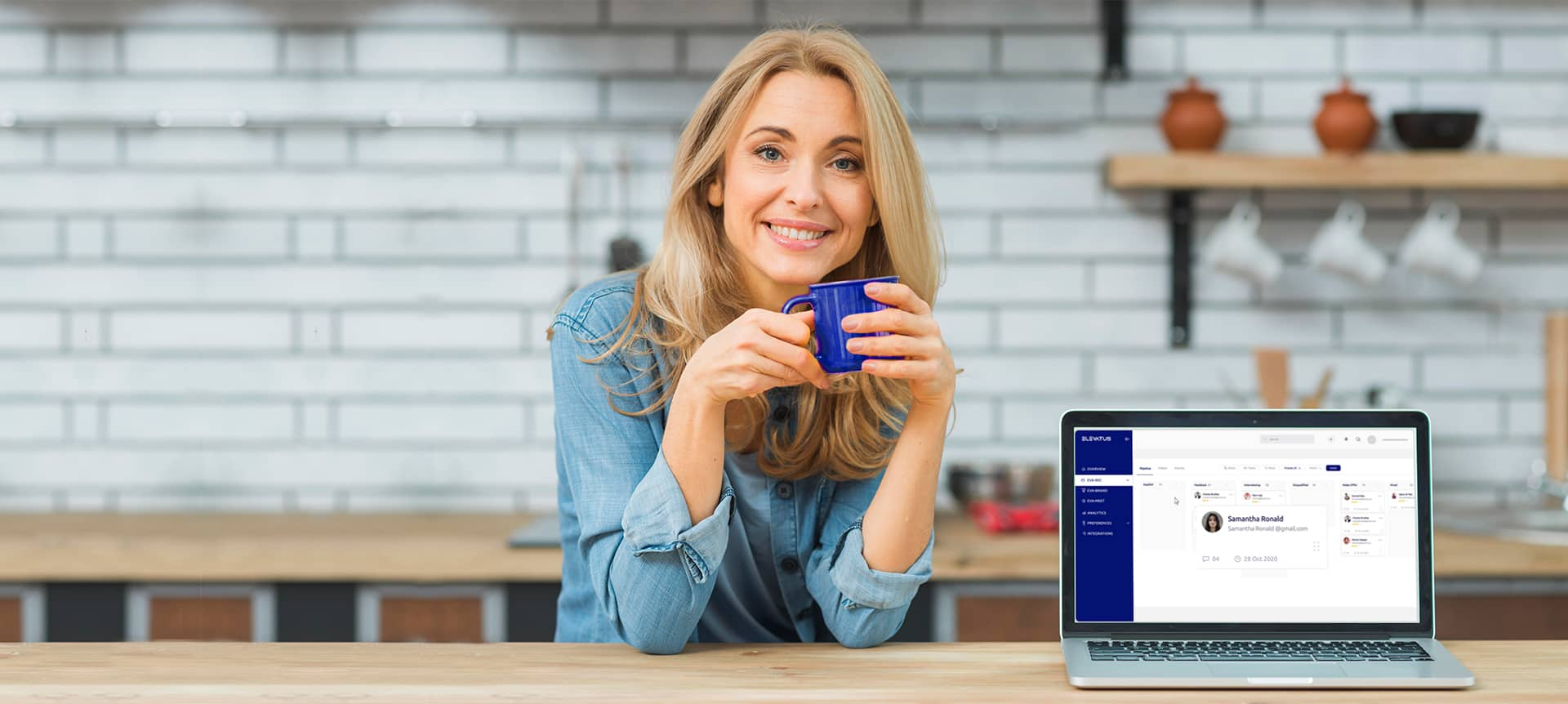 A recruiter who is drinking coffee and using the hiring solution, EVA-REC.
