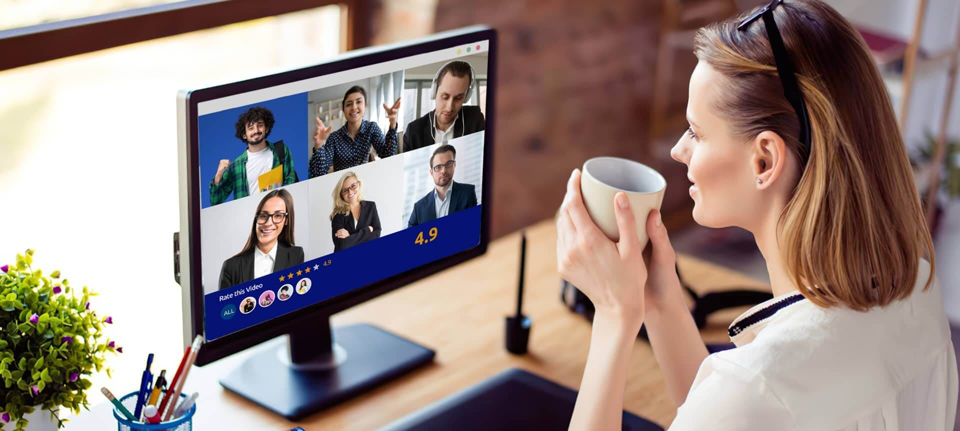A female talent acquisition specialist watching video interviews