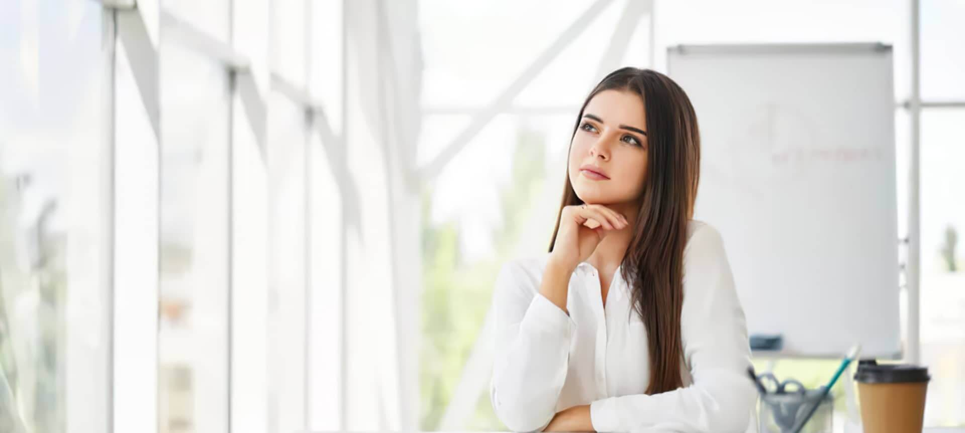 A female recruiter looking pensively to the side