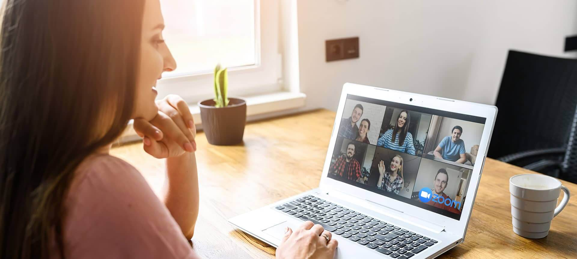 A female recruiter using video interviewing software to interview candidates