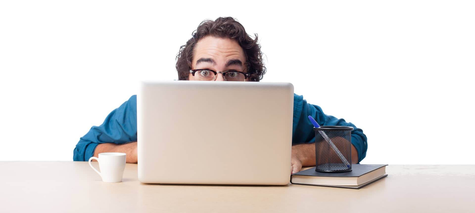 A male recruiter hiding behind his laptop screen