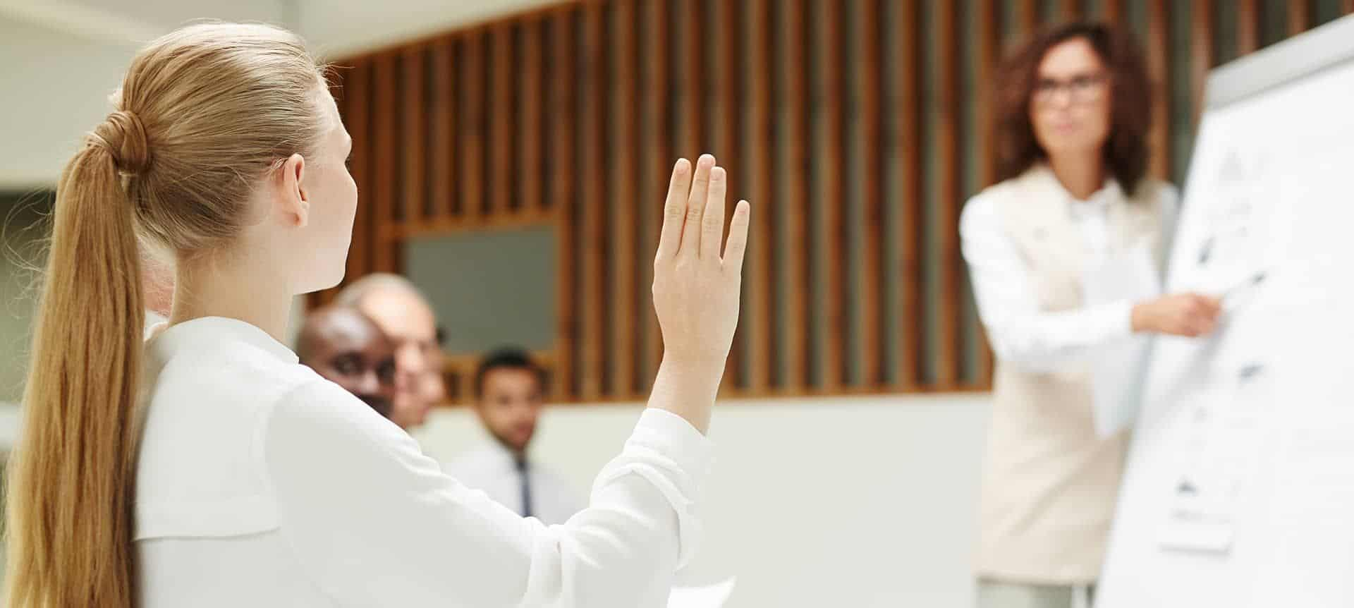 A female recruiter raising her hand