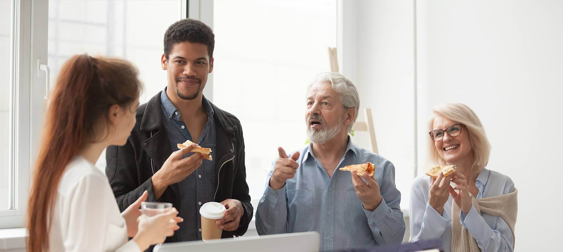 A group of employees having pizza at the office