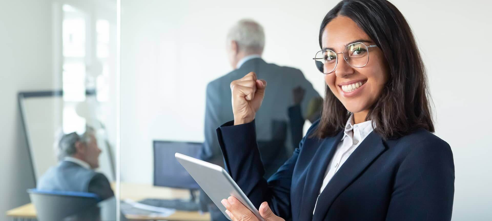 A recruiter wearing a suit and celebrating her success