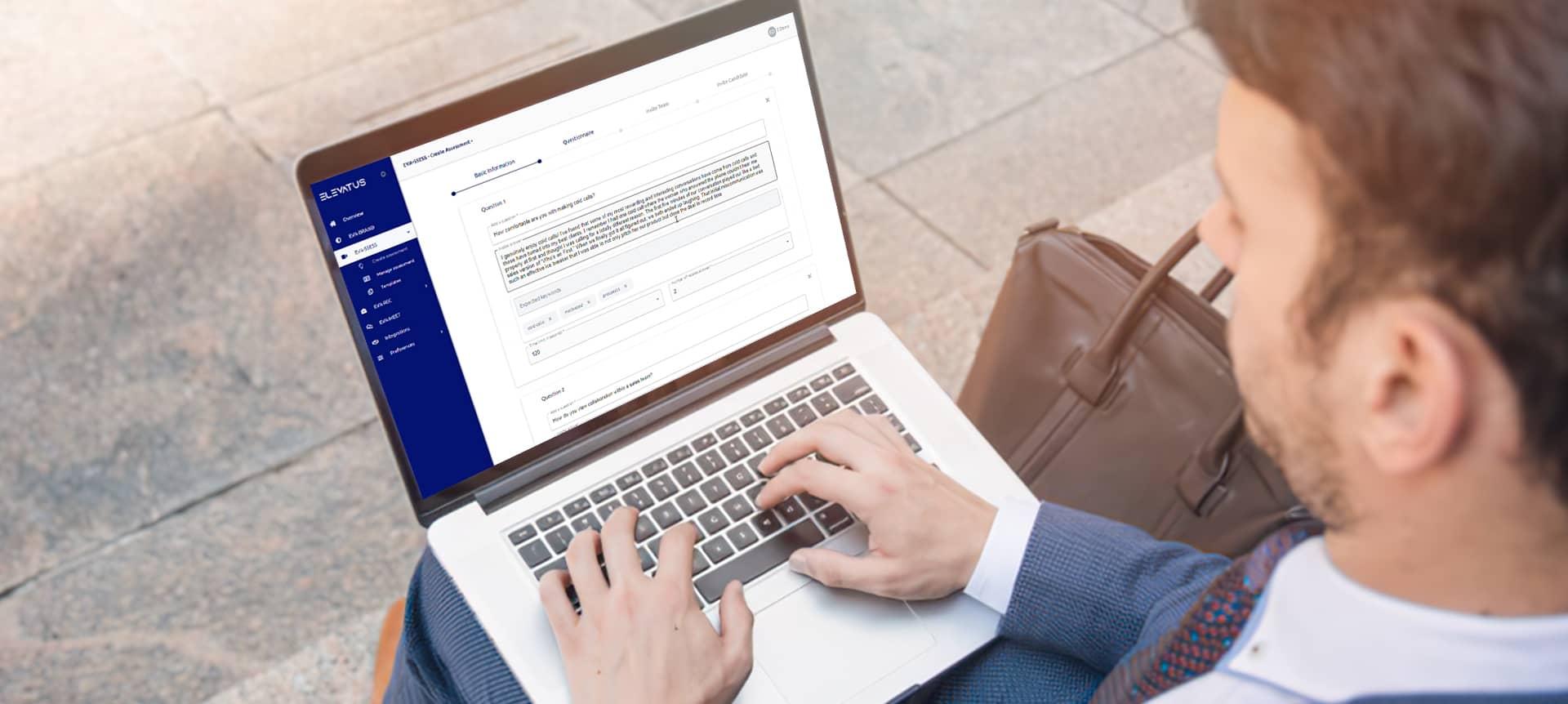 A recruiter using EVA-REC on his laptop to adjust job descriptions
