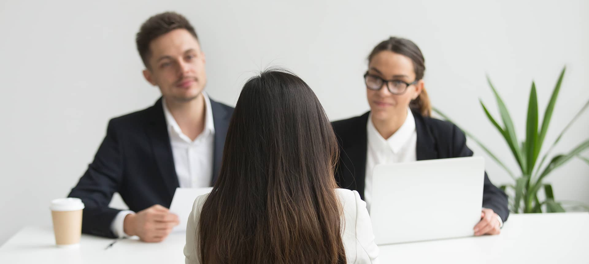 Recruiters reading and asking interview questions