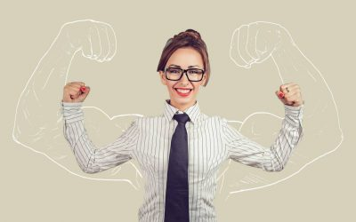 A female recruiter wearing a tie, glasses, and lifting her arms up, ready to boost the hiring hit-rate for video assessments.