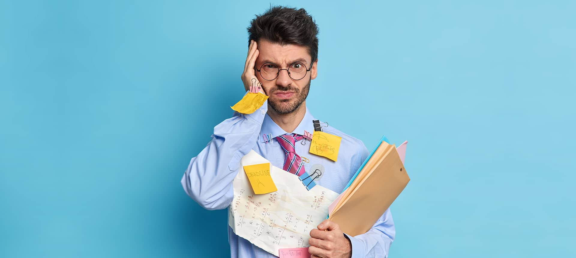 A male candidate with sticky notes all over him, looking unprepared for an interview.