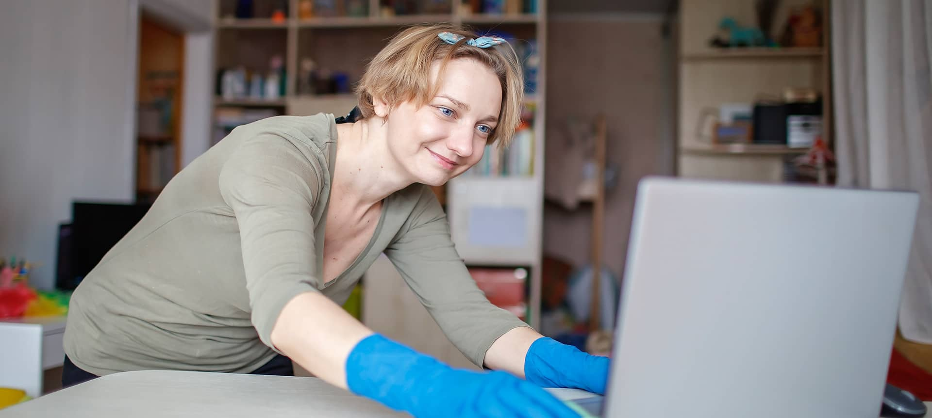 A female candidate working from home, trying to find the best background.