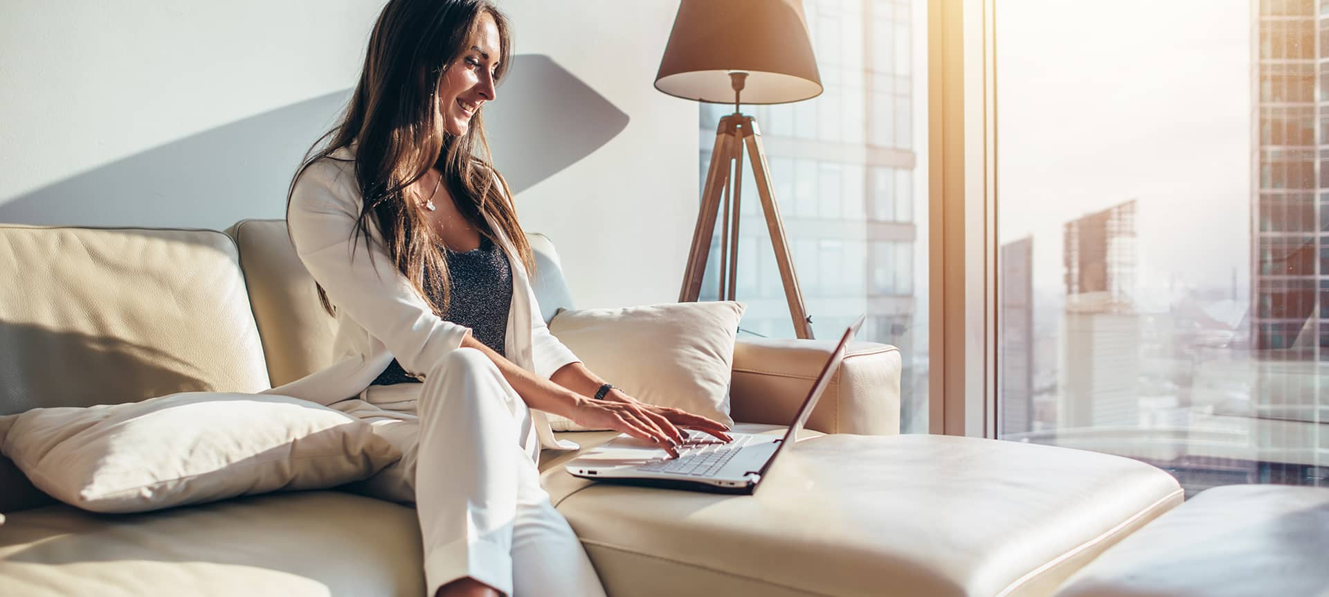 A female employee working remotely from her living room.