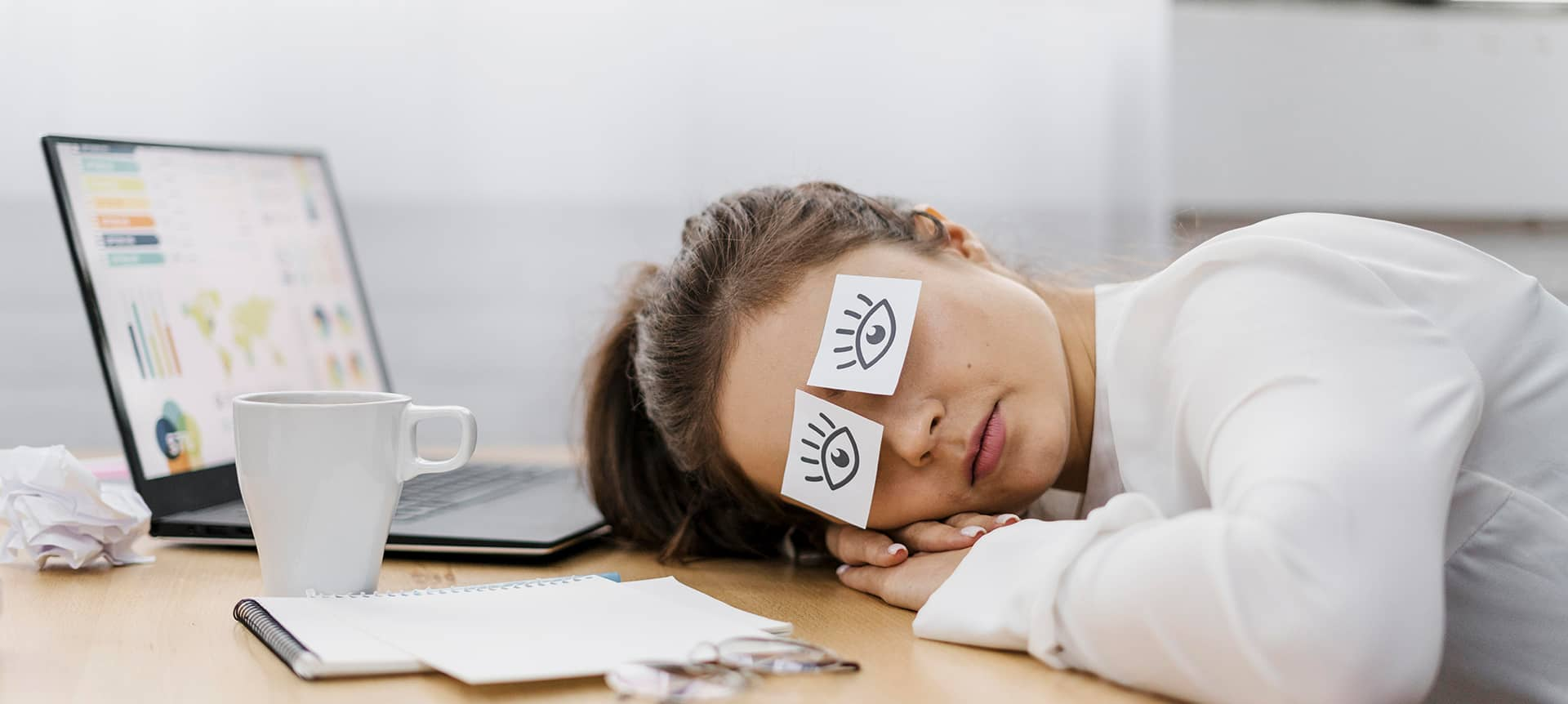 A recruiter who is tired and laying her head on her desk.