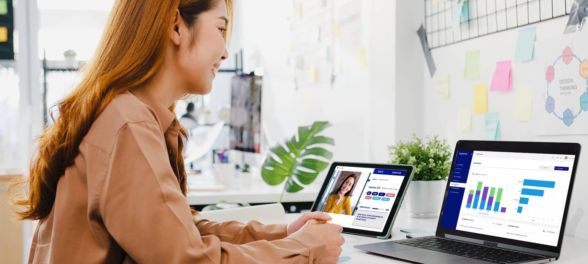 A female employee reading analytics on EVA-REC