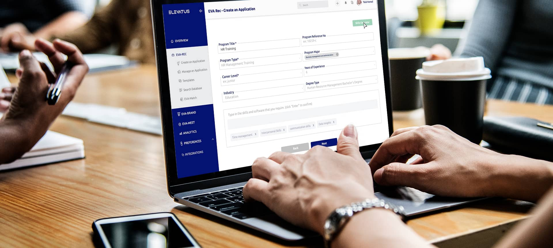 A recruiter using the hiring platform EVA-REC on the laptop