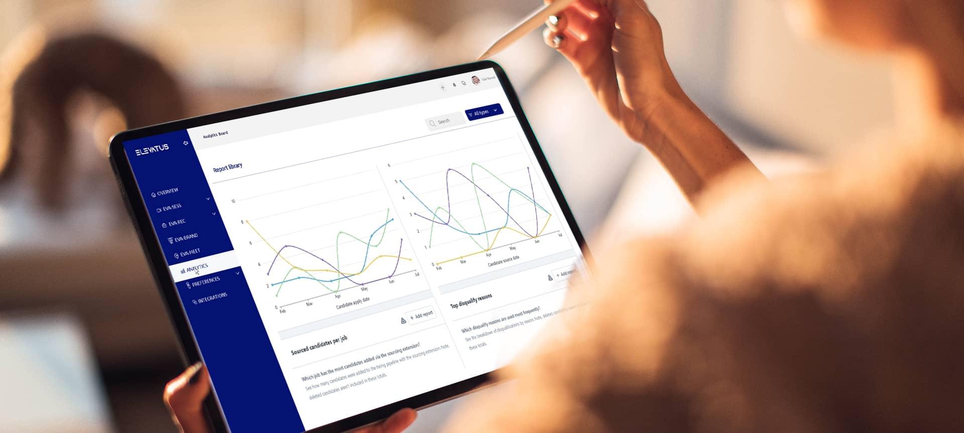 An HR professional reading analytics on a hiring platform