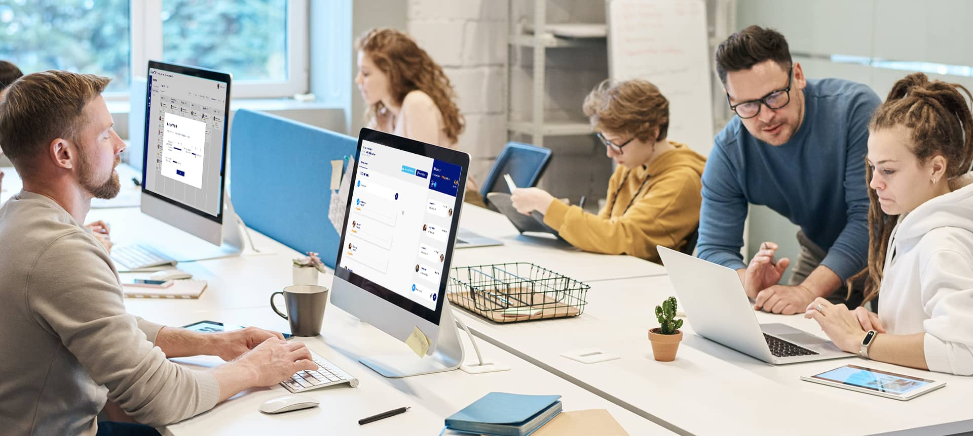 An HR team using recruitment software together