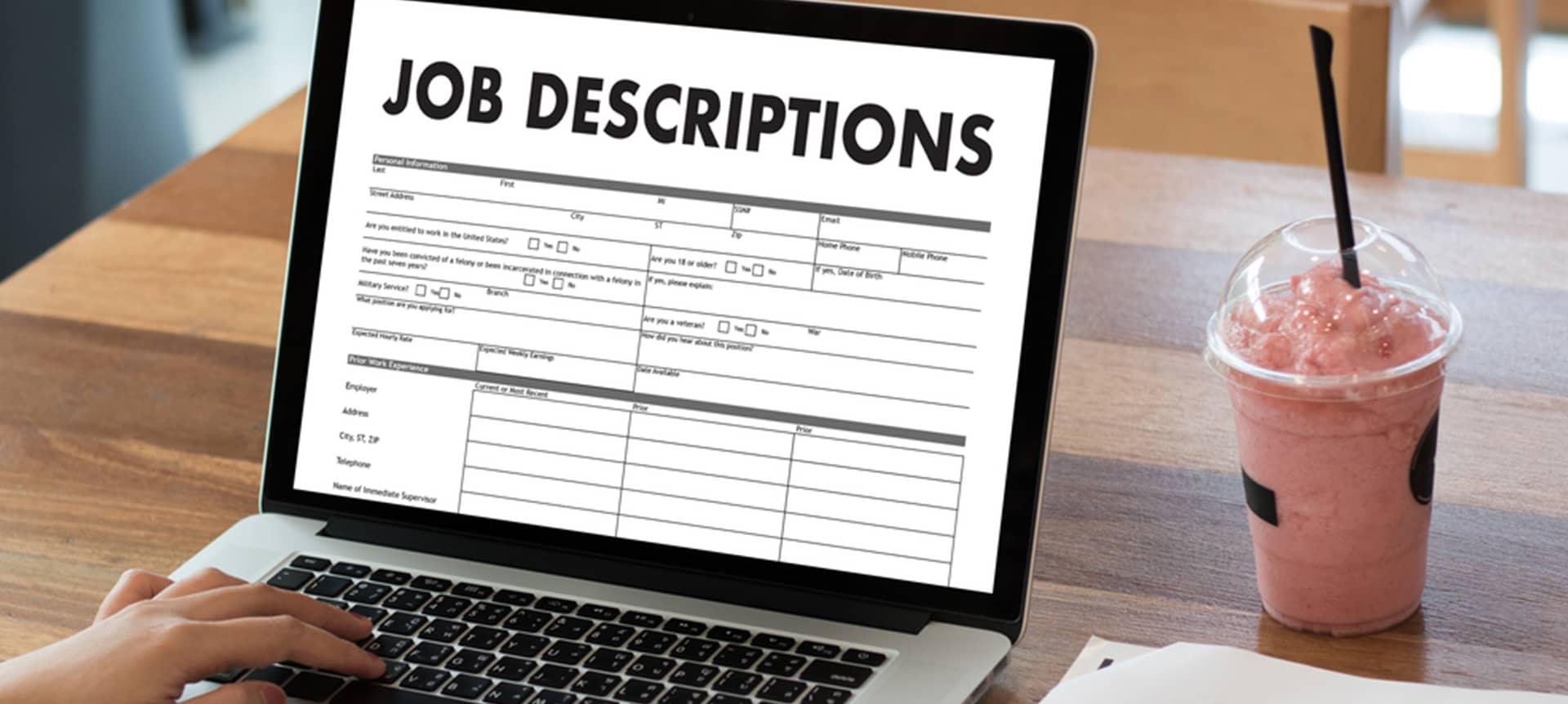 Laptop showing a job description