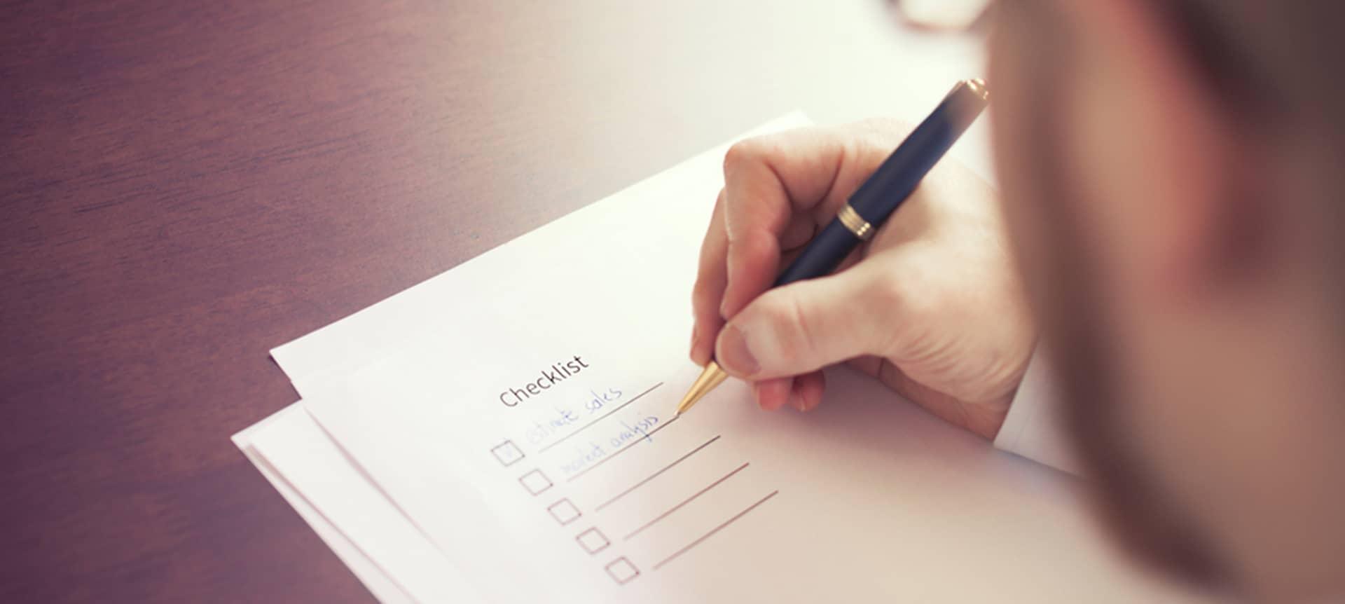Recruiter writing a checklist